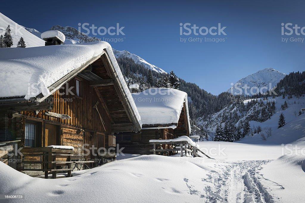 wooden houses on austrian mountains stock photo
