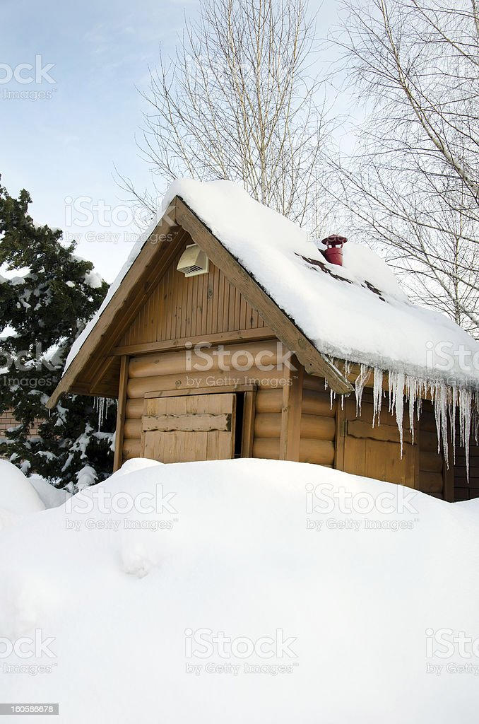 wooden hut under snow royalty-free stock photo