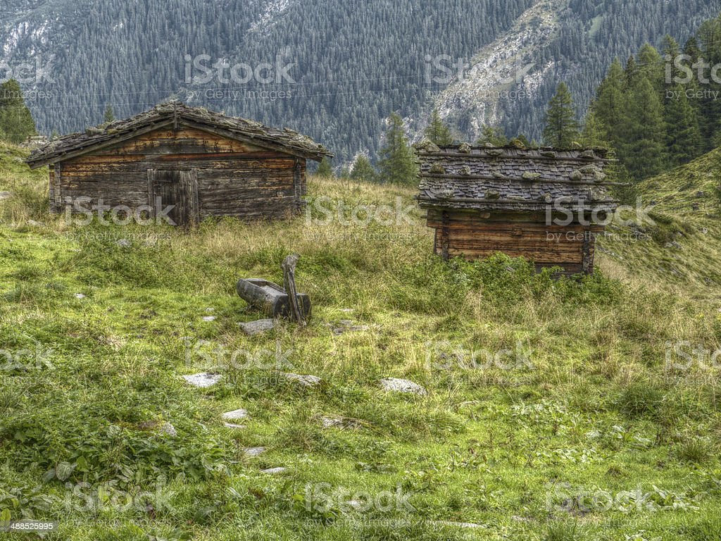 wooden huts on the mountains in HDR stock photo