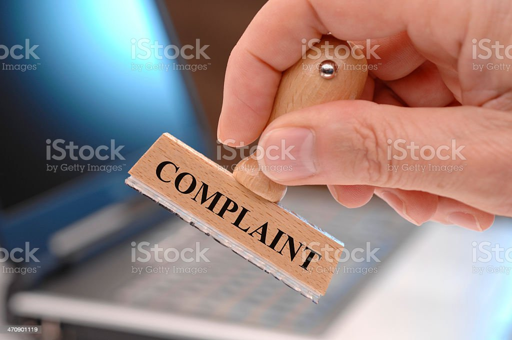 Wooden ink stamp for complaint stock photo