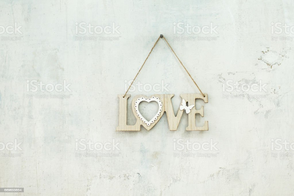 Wooden inscription love on the rope stock photo