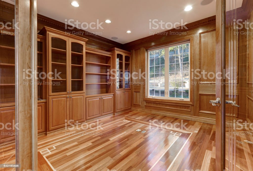 Wooden interior of empty room in luxury home stock photo