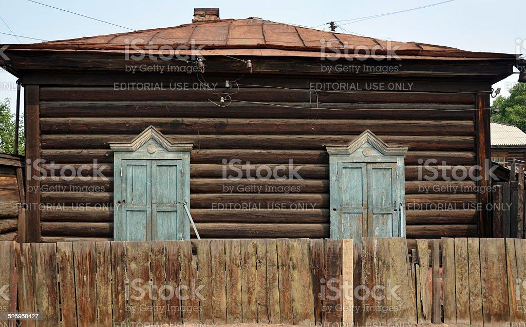 Wooden isba in Siberia stock photo