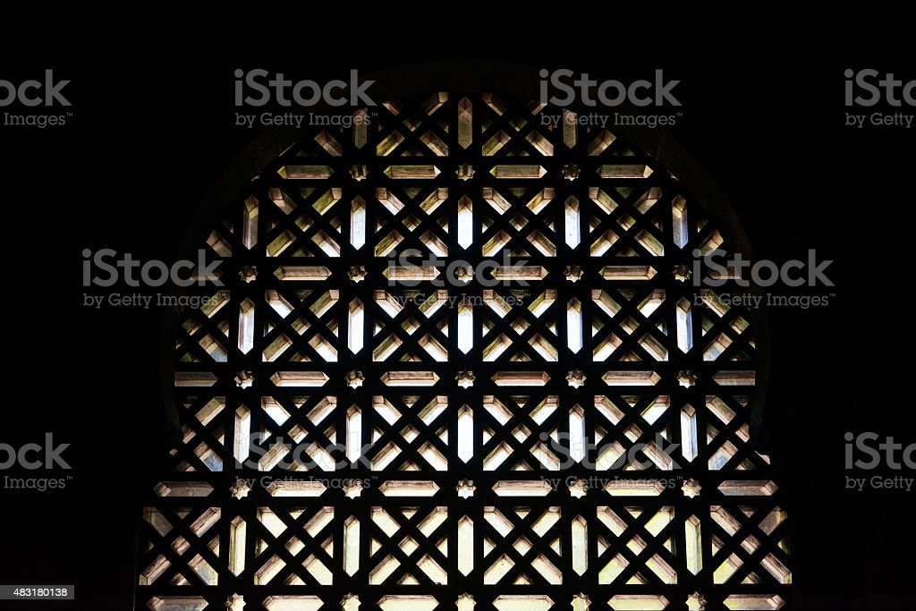 Wooden Islamic pattern on a window stock photo