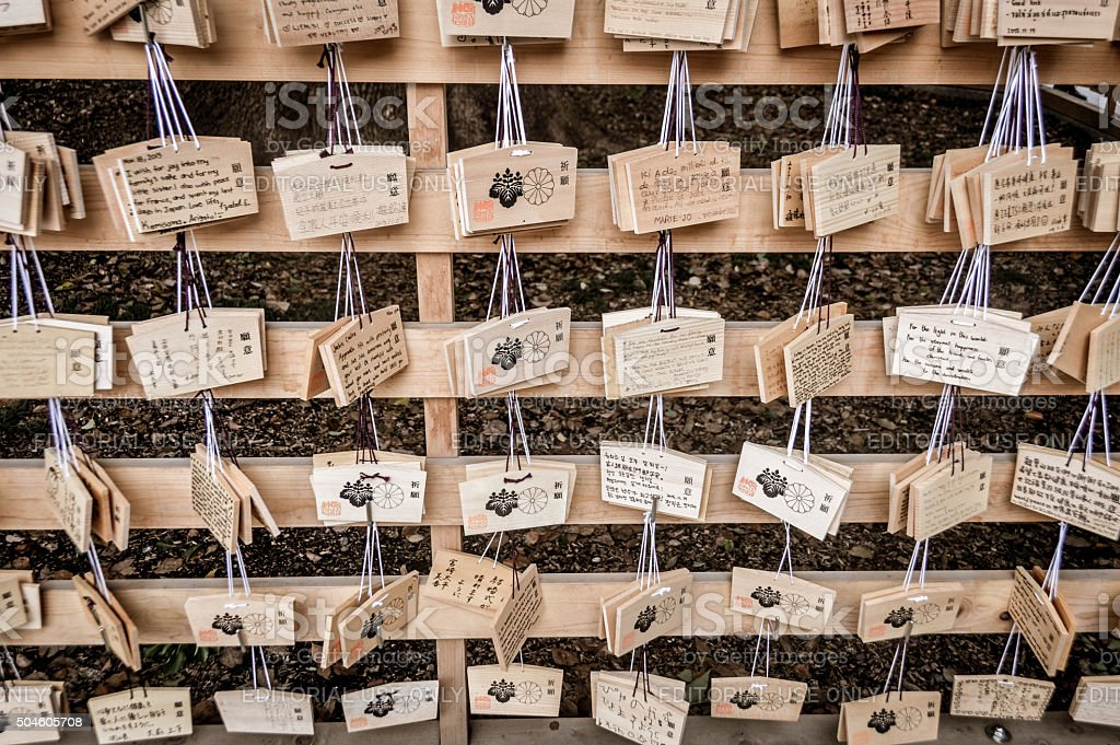Wooden Japanese prayer tablets with wishes stock photo