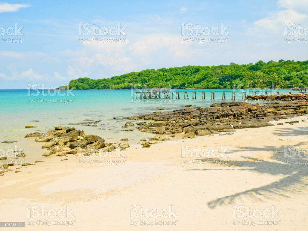 Wooden jetty and crystal clear water in Koh Kood Island stock photo