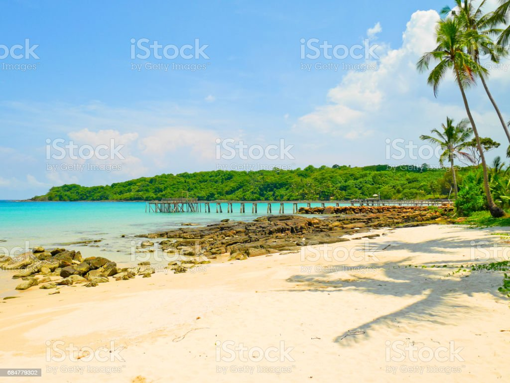 Wooden jetty and crystal clear water stock photo
