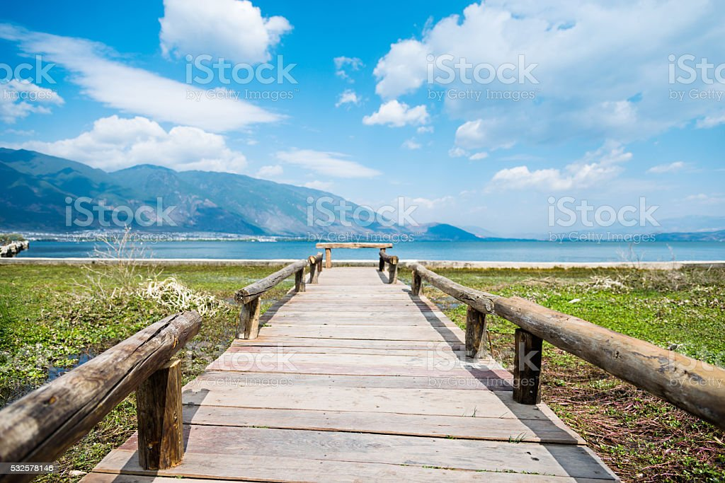 Wooden jetty and the lake stock photo