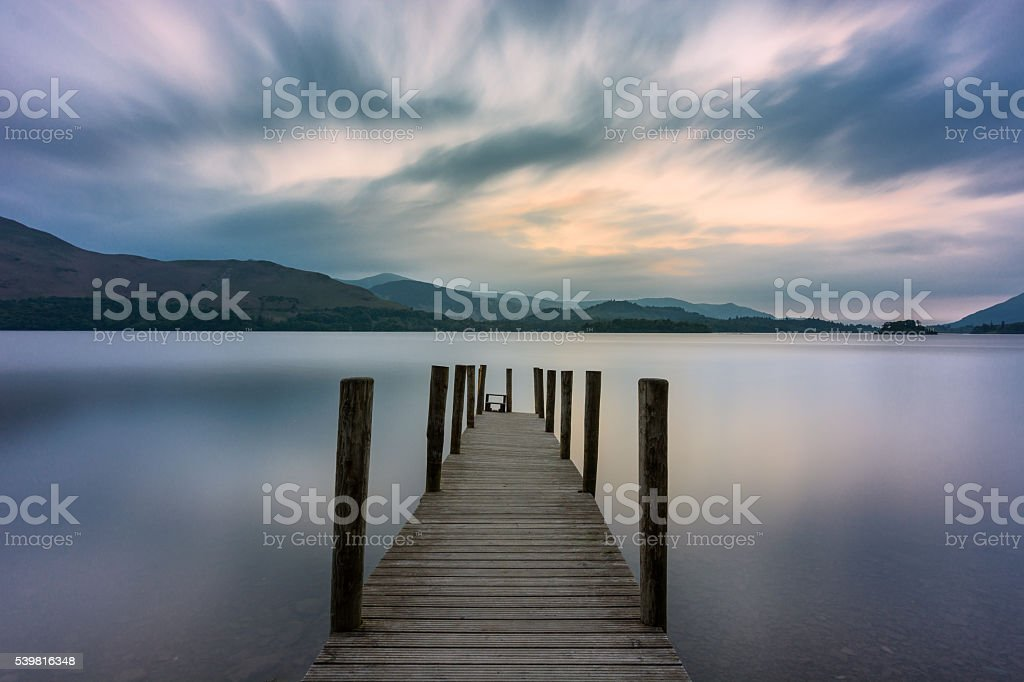Wooden Jetty At Derwentwater Lake With Moody Sky. stock photo