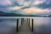 Wooden Jetty At Derwentwater Lake With Moody Sky.