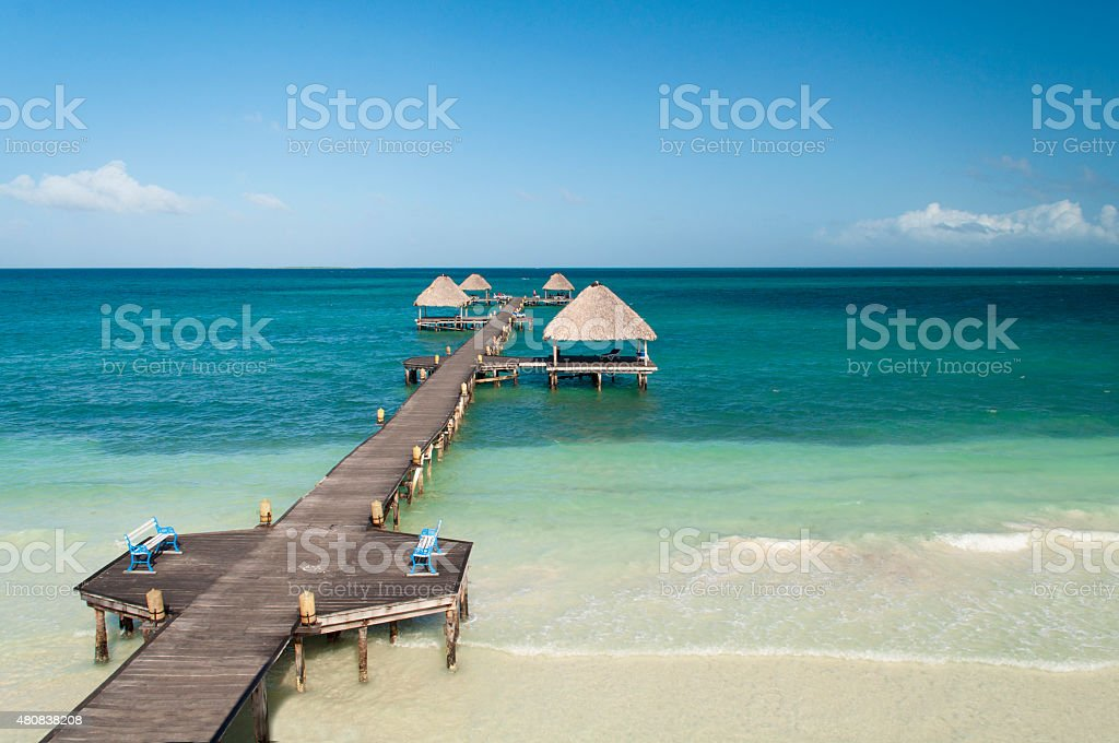 Wooden jetty in the Caribbean beach stock photo