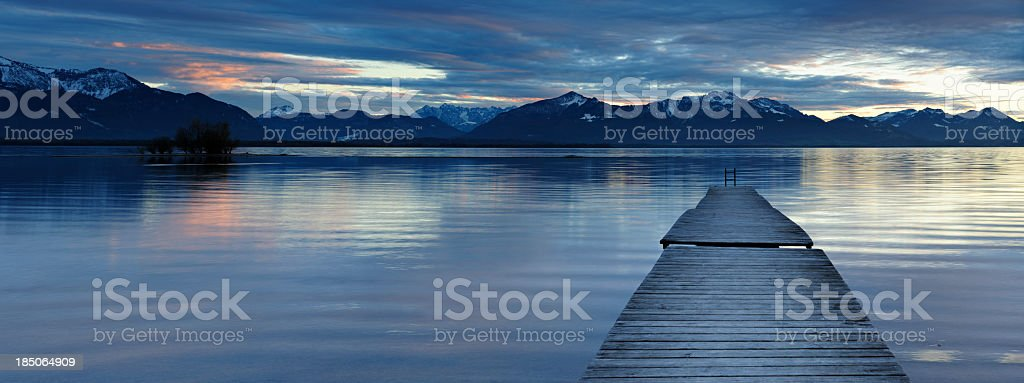 Wooden Jetty into Lake Chiemsee at Sunset stock photo