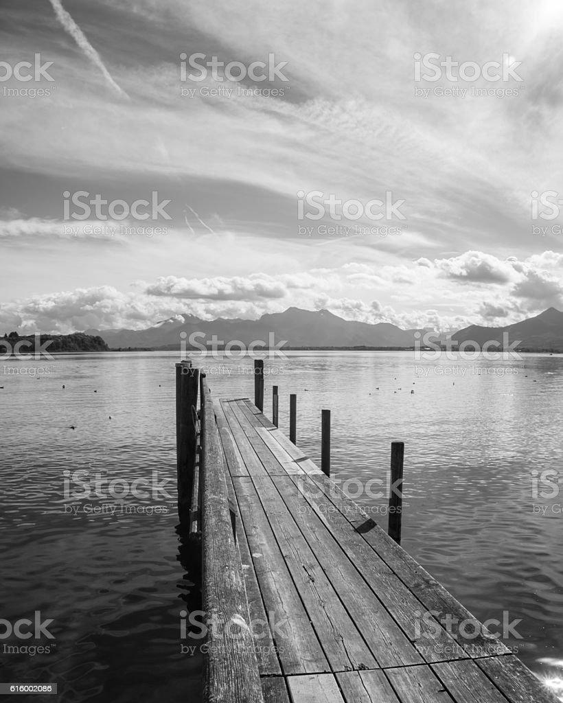 wooden jetty lake chiemsee stock photo