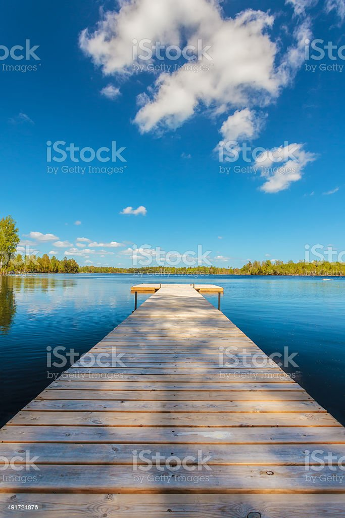 Wooden jetty on a sunny day in Sweden stock photo