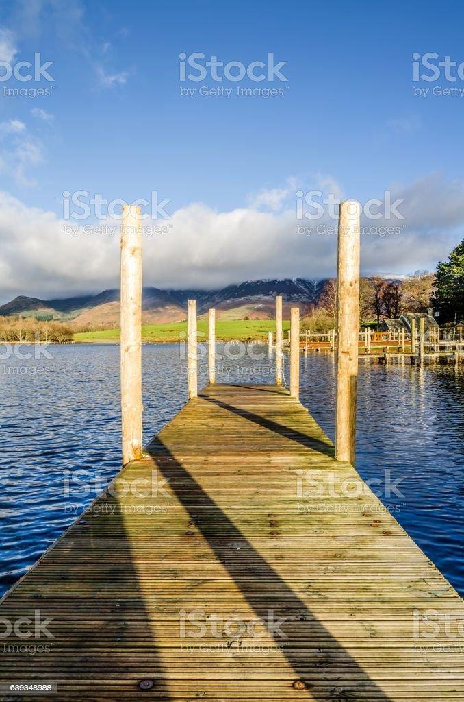 Wooden jetty on Derwentwater stock photo