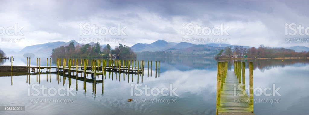 Wooden Jettys Along Mountain Lake stock photo