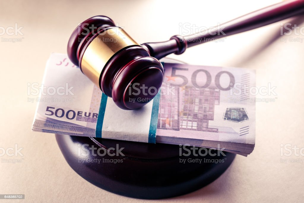 Wooden judge's gavel and euro stock photo