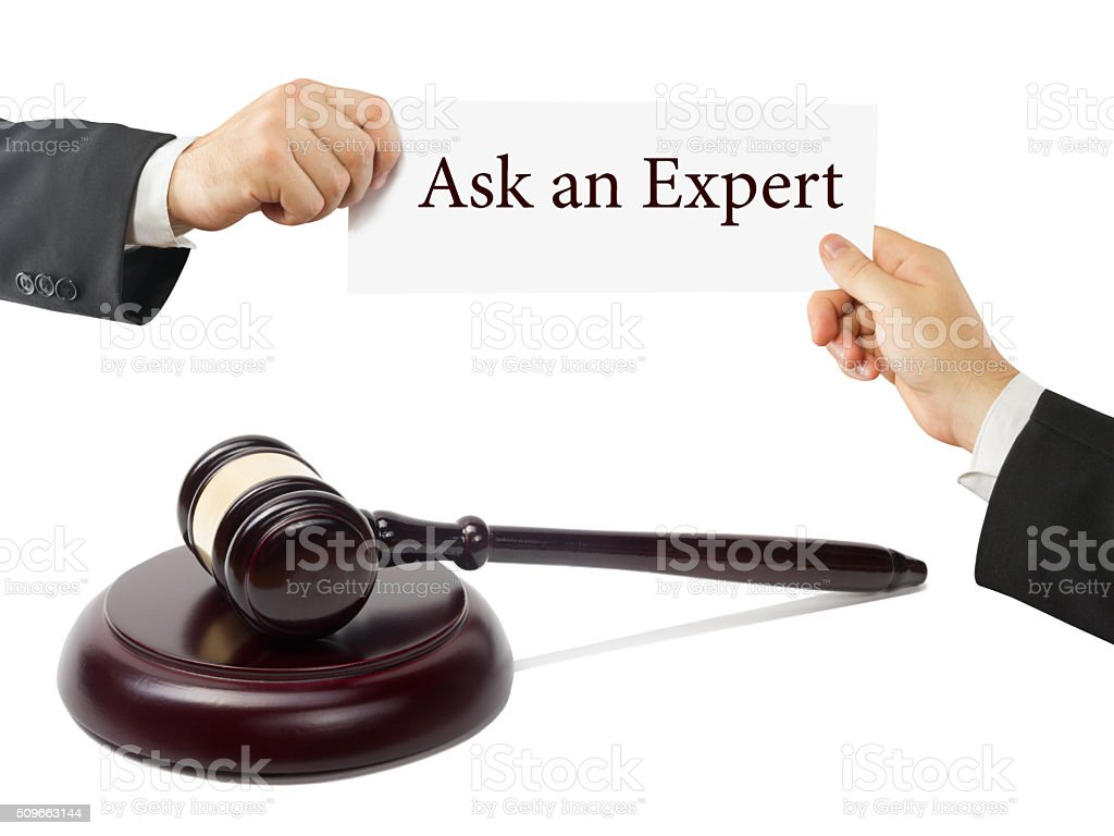 Wooden judges gavel on table in a courtroom or law stock photo