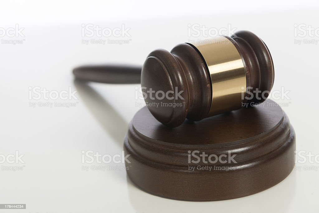 Wooden judge's gavel on white stock photo