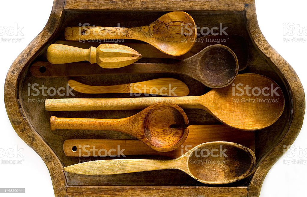 Wooden kitchen utensils on a vintage tray royalty-free stock photo