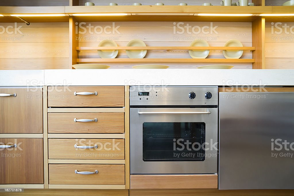 Wooden kitchen with a modern stainless steel cooker royalty-free stock photo