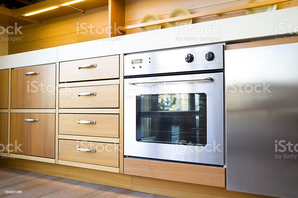 Wooden kitchen with stainless steel cooker stock photo