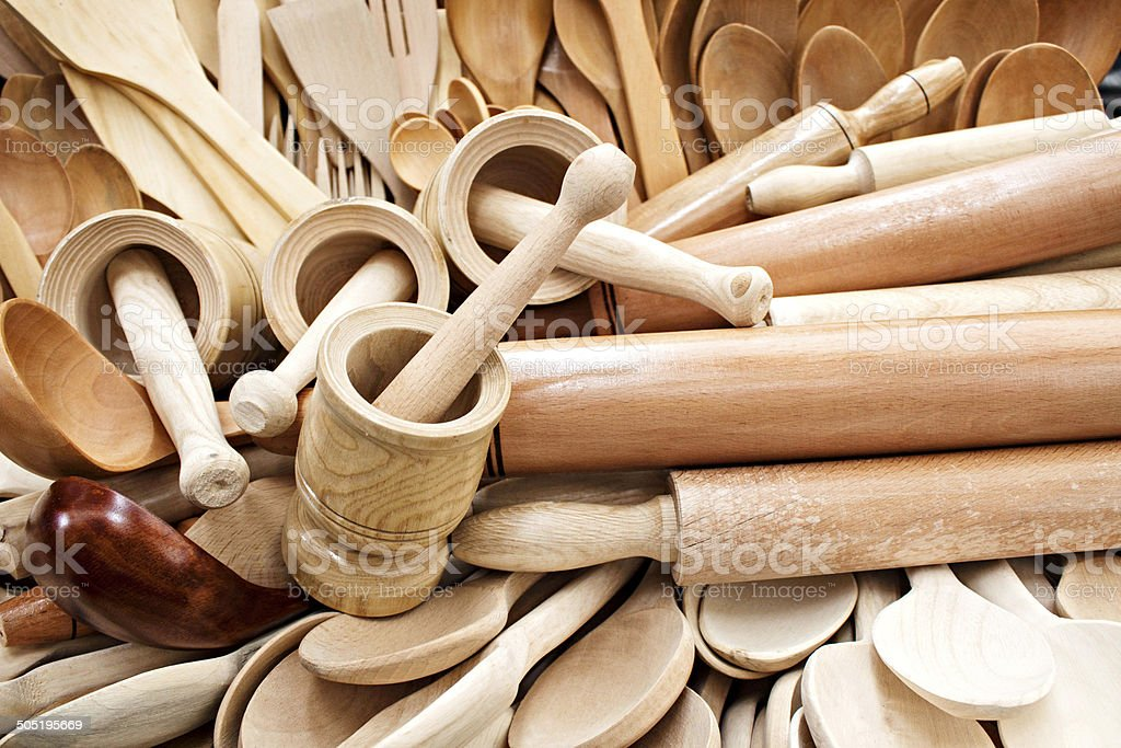 Wooden kitchenware and garlic press stock photo
