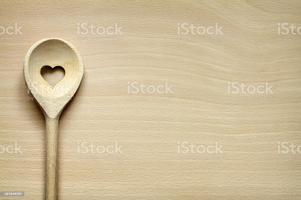 Wooden kitchenware on cutting board stock photo