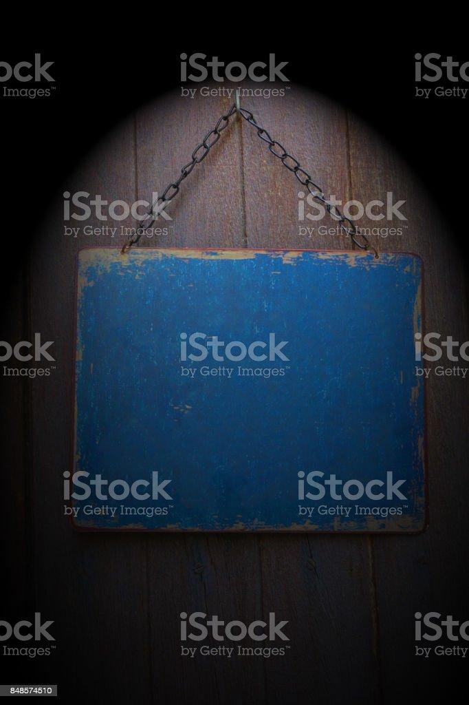 Wooden label hang on the door with lightspot stock photo