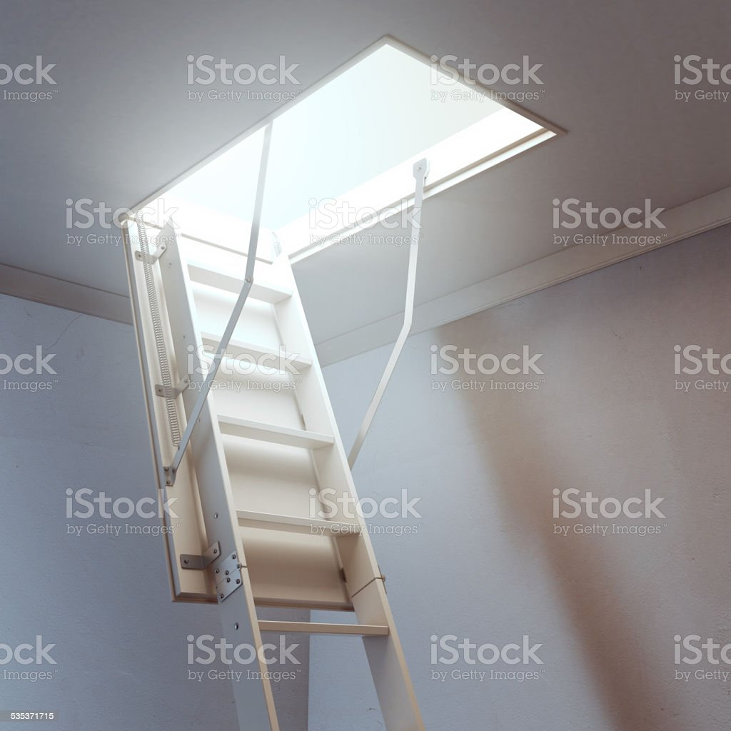 wooden ladder to the attic stock photo
