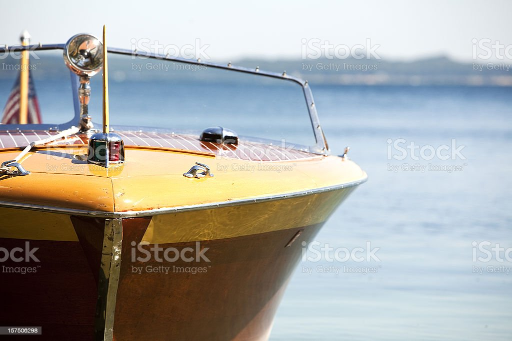 wooden lake michigan antique vintage power boat in blue daylight stock photo