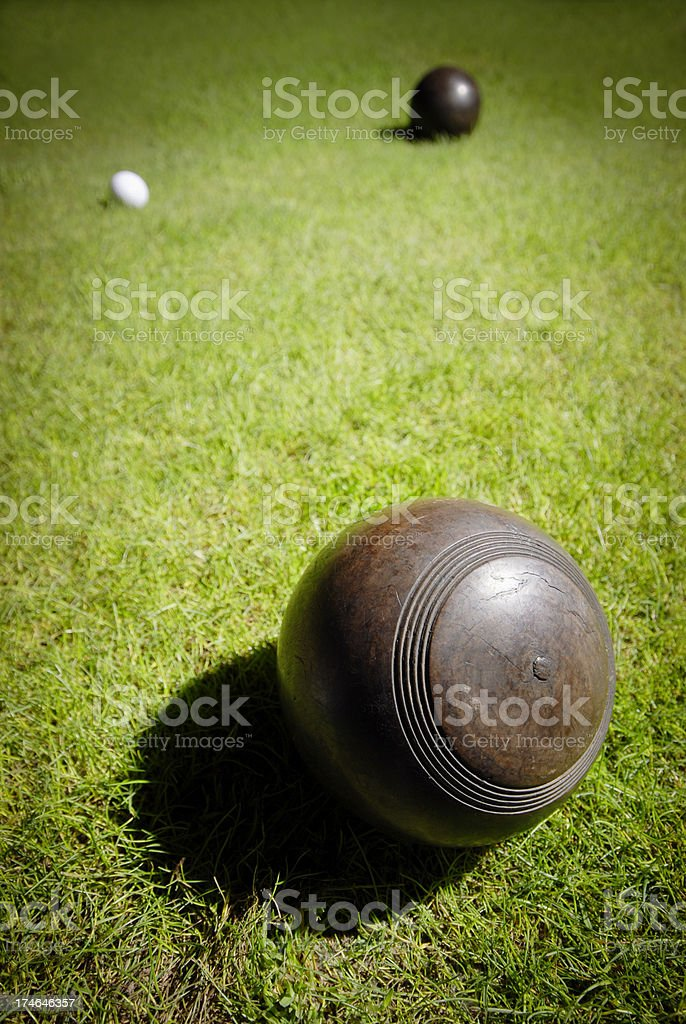 Wooden lawn balls on grass close to a jack stock photo