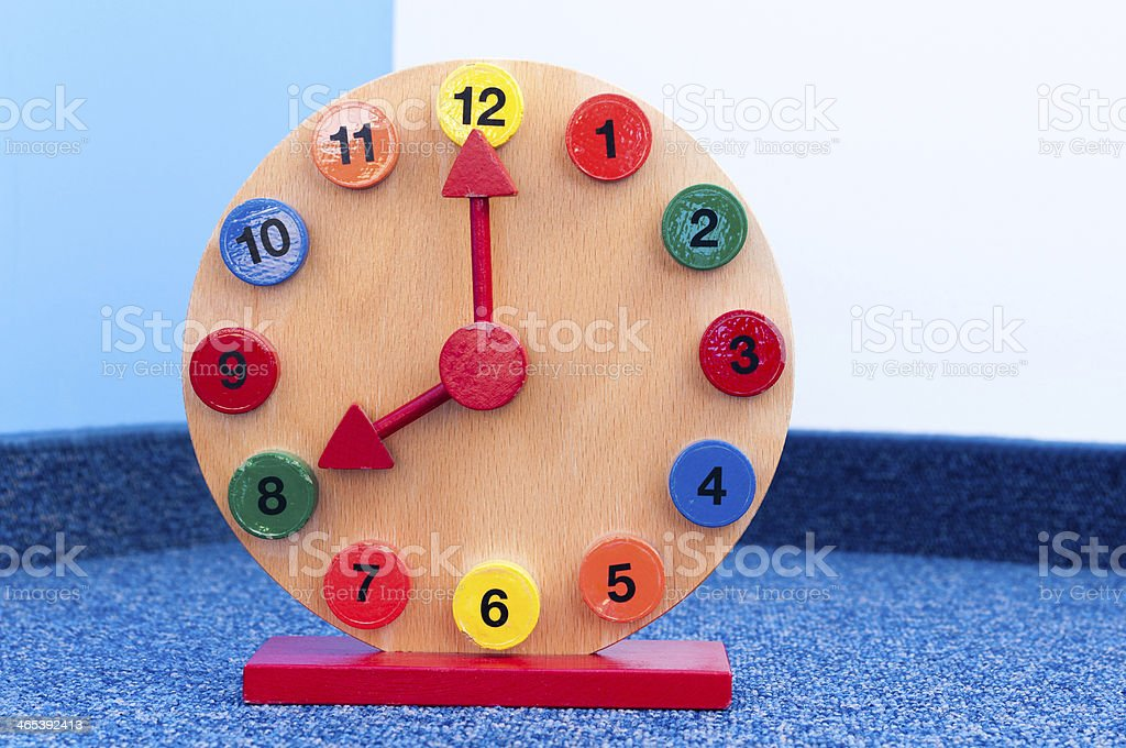 Wooden Learning Clock with pointer position at eight stock photo