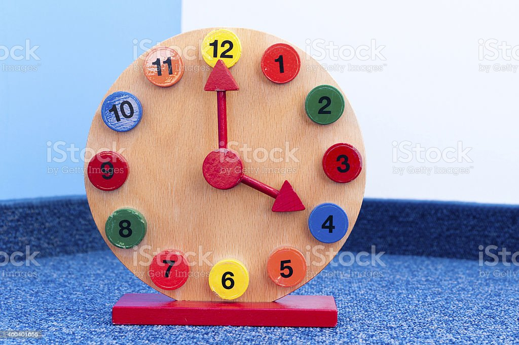 Wooden Learning Clock with pointer position at four stock photo