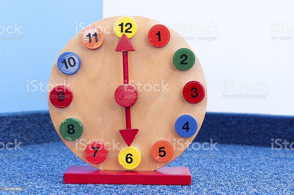 Wooden Learning Clock with pointer position at six stock photo