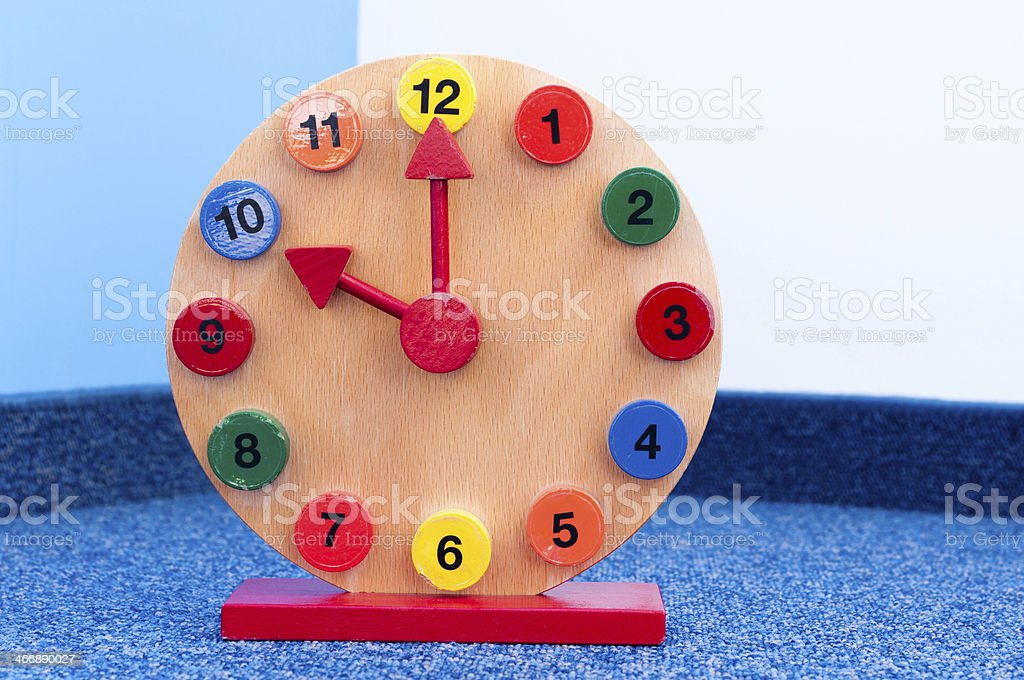 Wooden Learning Clock with pointer position at ten stock photo