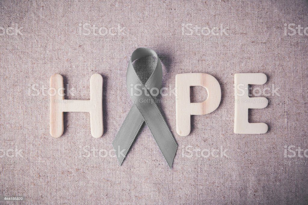 HOPE wooden letter with grey ribbon, Brain cancer awareness, Brain Tumors,Asthma awareness, Allergies and Diabetes awareness stock photo