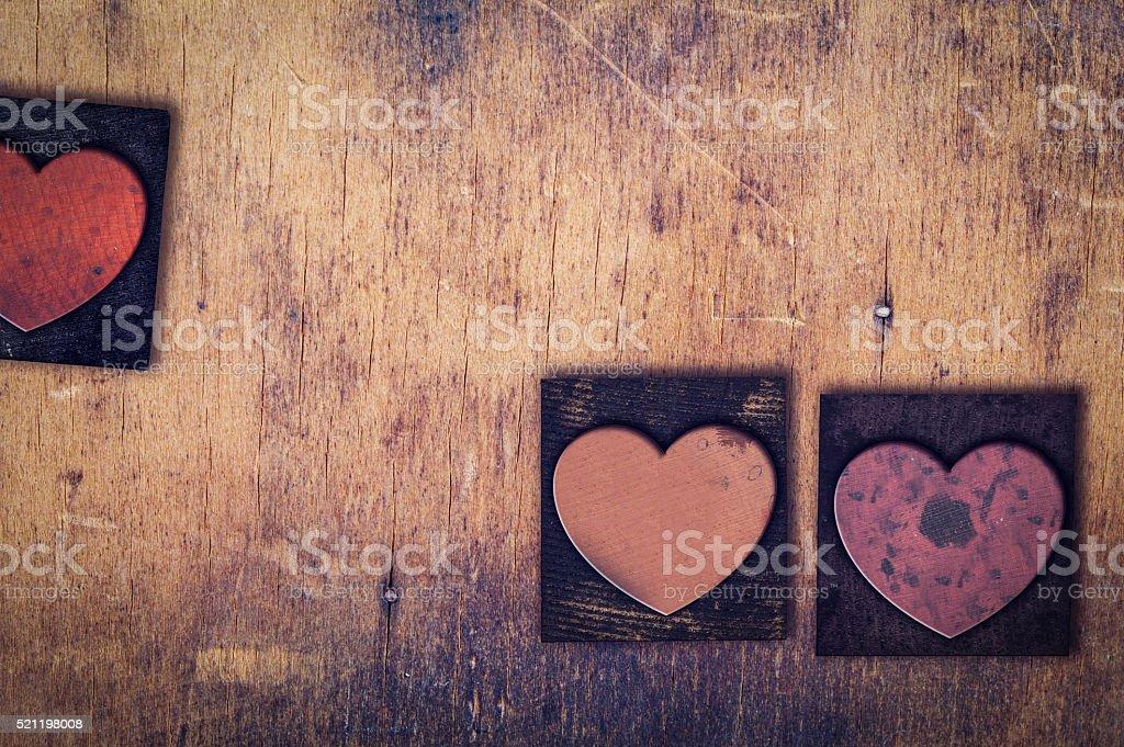 3 Wooden Letterpress Hearts stock photo