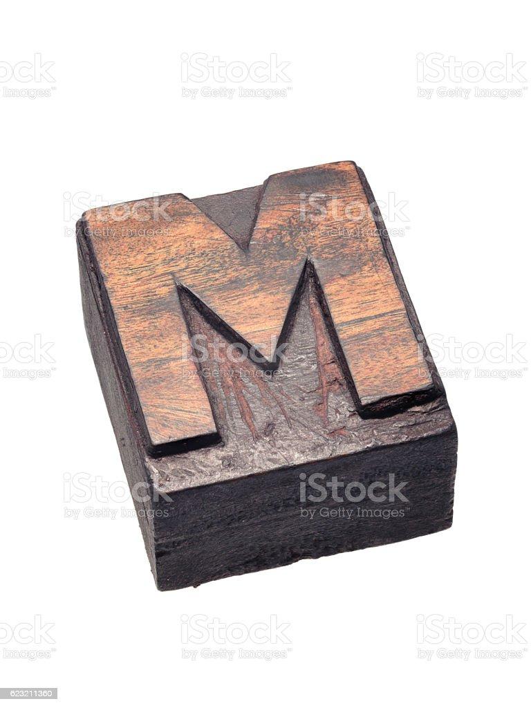 wooden letterpress M block stock photo