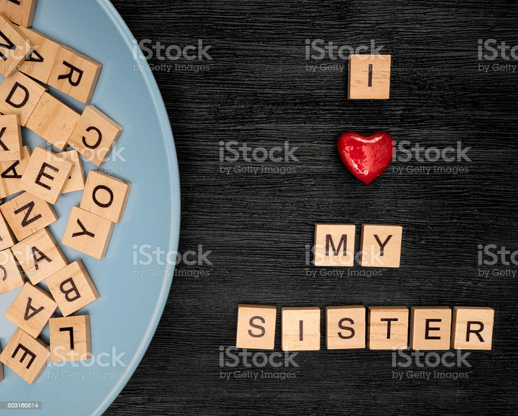 Wooden letters spelling I love my  sister stock photo