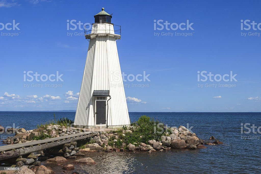 Wooden lighthouse stock photo