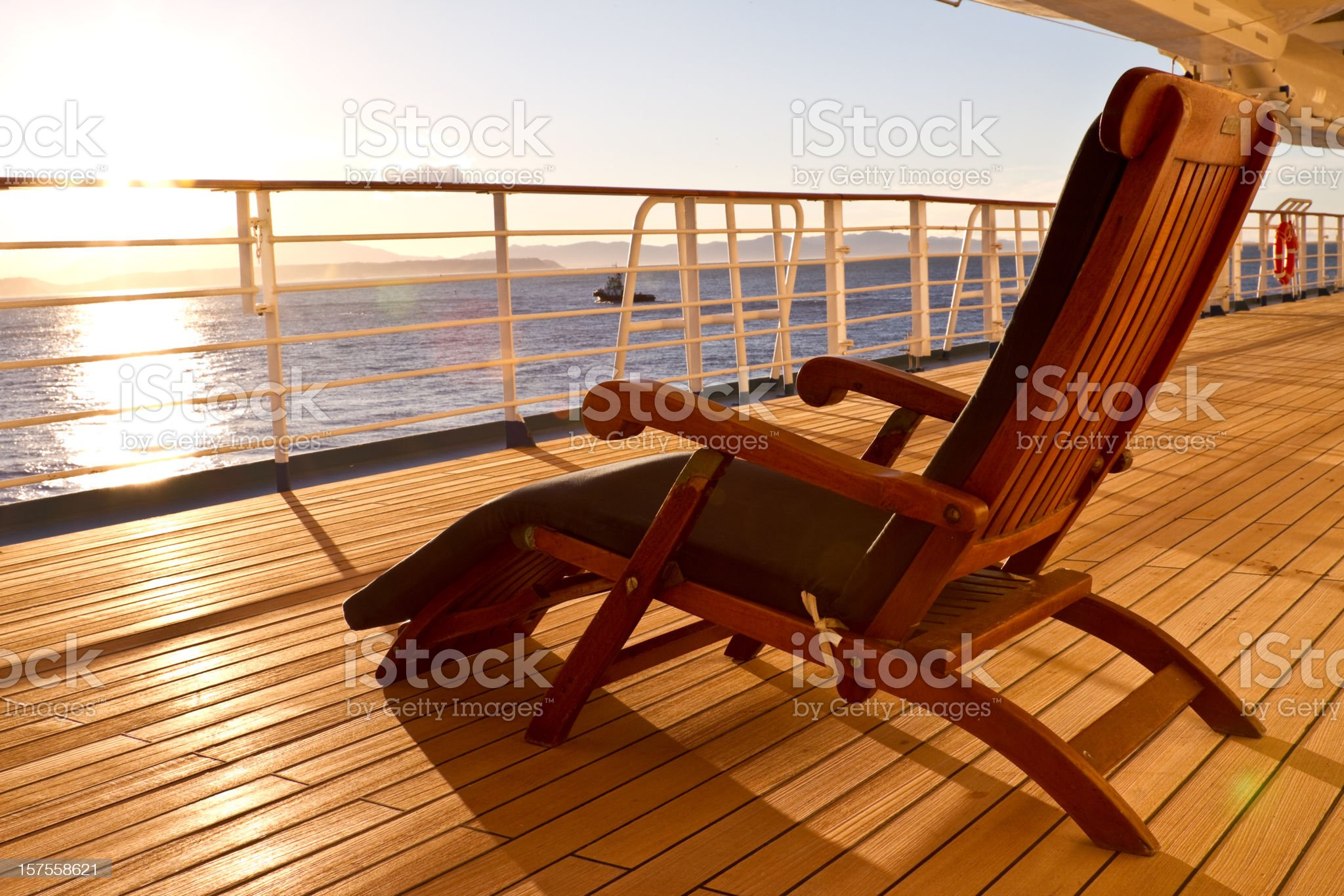 Wooden lounge chair on the deck of a cruise ship royalty-free stock photo