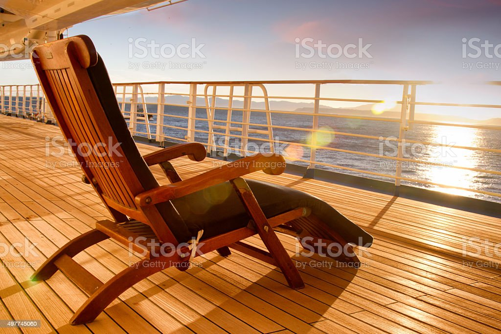Wooden lounge chair stock photo