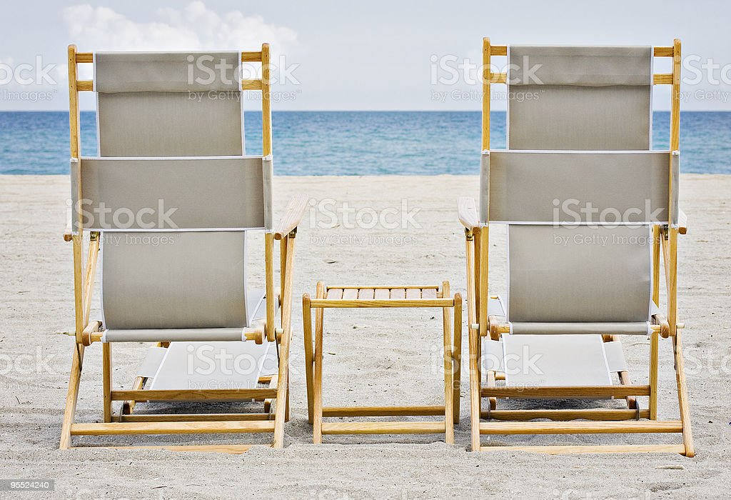 Wooden lounging chairs on the tropical beach in Miami stock photo