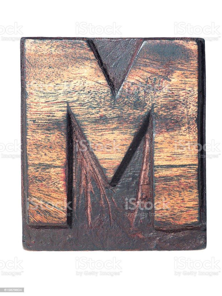 wooden M typeface stock photo