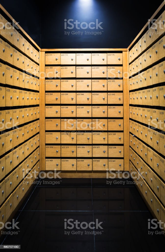 Wooden mail boxes in condo stock photo
