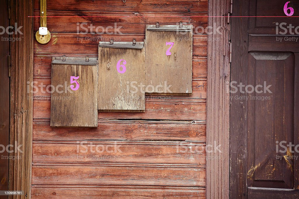Wooden mailboxes on a wall royalty-free stock photo
