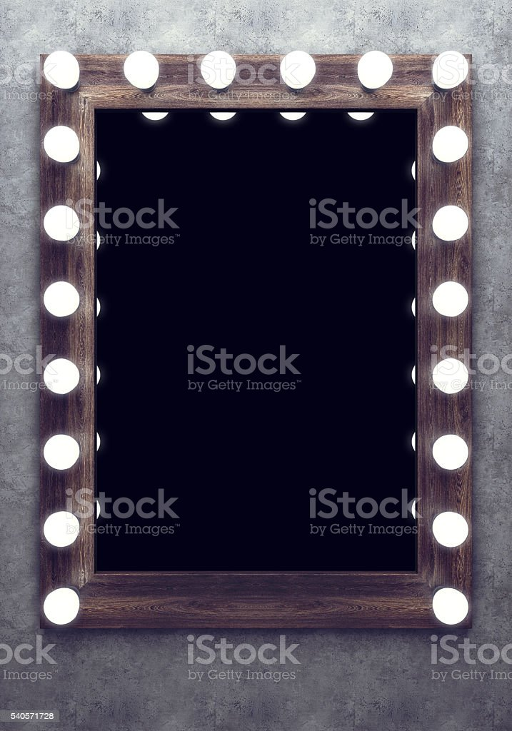 Wooden makeup mirror on the concrete wall stock photo