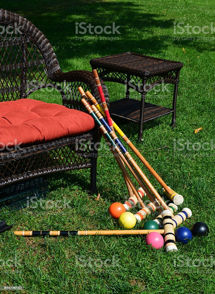 Wooden mallets and ball for croquet. stock photo