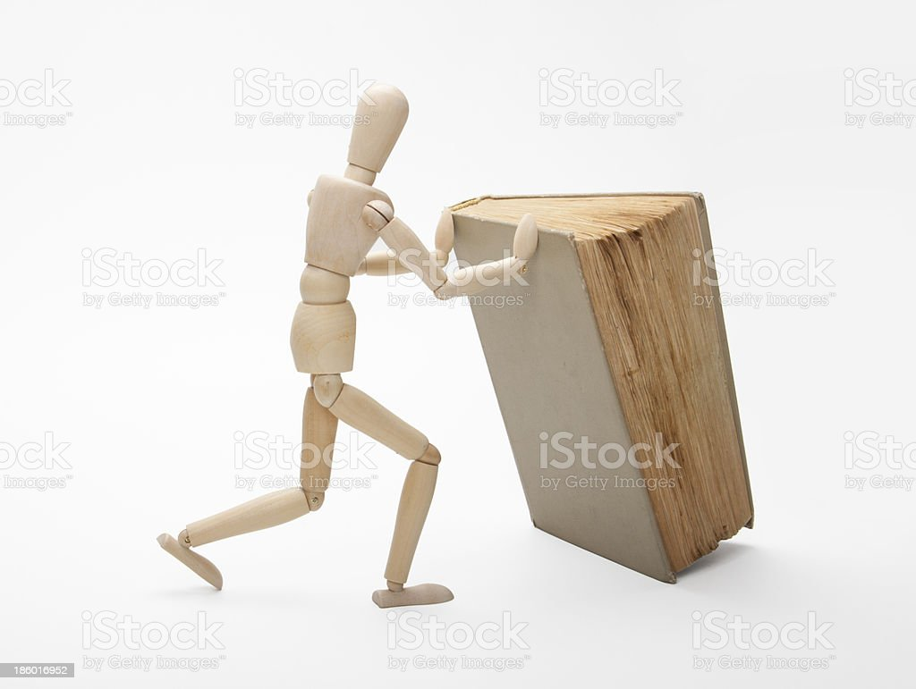 Wooden man and book royalty-free stock photo